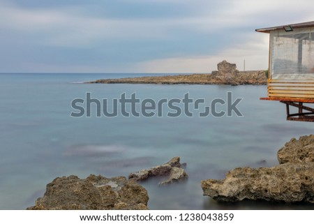 Long exposure in Antalya, with brown rocky seaside and cloudy weather. Longexposure time 4 minutes Stok fotoğraf ©