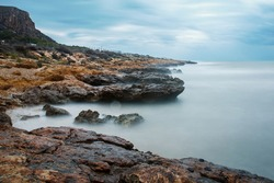 Long exposure landscape of a rocky coastline in Santa Pola del Este