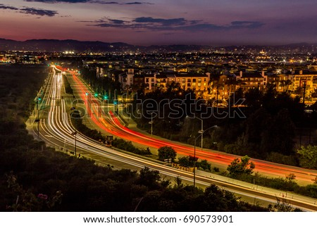 Shutterstock Long-exposure light streaks of traffic at dusk over a busy road in Playa Vista, California