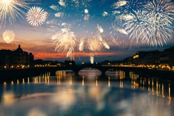 Long exposure night photography of the Ponte Vecchio, Florence-Italy and fireworks.