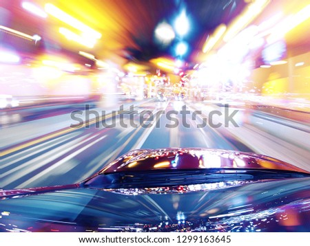 Long Exposure of a nightdrive through us american streets with motion-blured citylights and catchy colors