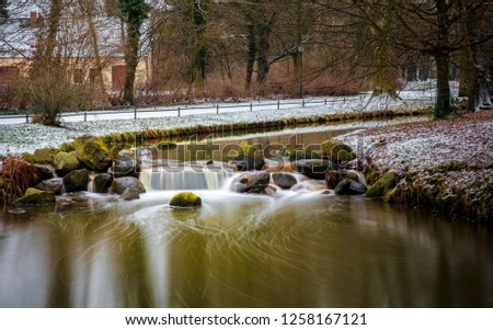 Long exposure of a small river in the park of Kromlau in Saxony, Germany #1258167121