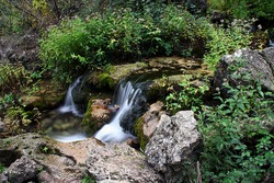 long exposure of a small waterfall near of the mundo river source, in Albacete, Spain