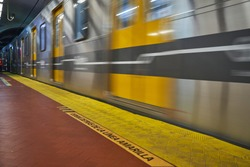 long exposure of a subway underground train in a metro station with motion blur to express dynamics of a moving object.