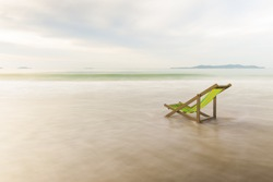 Long exposure of beach chairs on the white sand beach background