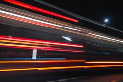 Long exposure of Bus driving past Busstation