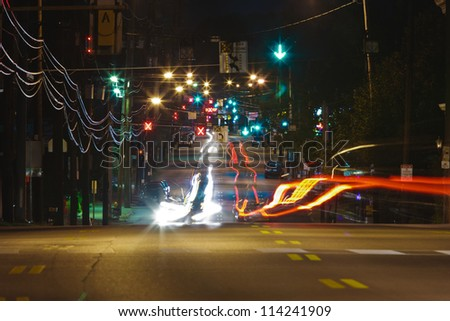 Long Exposure of car headlights and taillights on a city street at night.