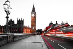 Long exposure of cars and taxis crossing the Westminster bridge with big ben in the background in the evening