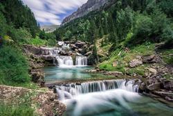 long exposure of Gradas De Soaso waterfall at Arazas river during summer, Ordesa National Park, Huesca, Spain