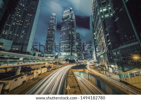 Long exposure of Hong Kong Cityscape skyscaper which have light traffic transportation from car or bus on Central Business District around IFC building, Hong Kong #1494182780