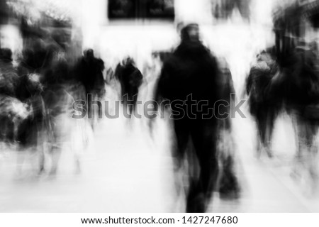 Long exposure of pedestrians walking along the high street - intentional camera shake to introduce an impressionistic effect and light trails - creative filter applied creating a ghostly aesthetic ストックフォト ©