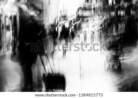 Long exposure of pedestrians walking through a shopping centre - intentional camera shake to introduce an impressionistic effect and light trails - creative filter applied creating a ghostly aesthetic ストックフォト ©