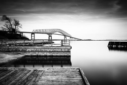 Long exposure of piers in the Patapsco River and the Francis Scott Key Bridge, from Fort Armistead Park, Maryland.