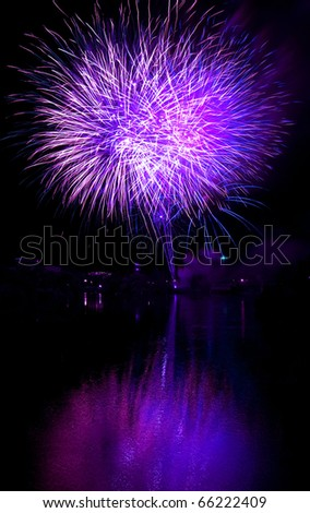 Long Exposure of Purple Fireworks Against a Black Sky