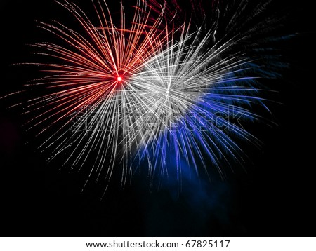 Long Exposure of Red White and Blue Fireworks Against a Black Sky - stock photo