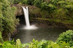 Long exposure of scenic Rainbow Falls of the Wailuku River, nestled among the lush green rainforest, near Hilo, Hawaii