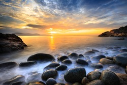 Long exposure of sea and stones, beautiful sunrise in Quy Nhon city, Vietnam