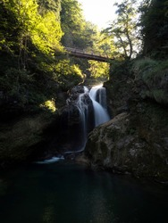 Long exposure of Slap Sum waterfall bridge, soft sun light at Vintgar Gorge Canyon Radovna river in Lake Bled Slovenia Europe