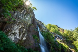 Long exposure of Sotillo waterfall in Sanabria with starry sun and text space