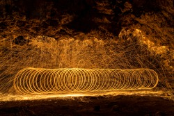 Long exposure of spinning burning steel (wire) wool creating beautiful and unique shapes.