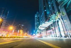 Long exposure of street at night with passing cars Dubai - UAE