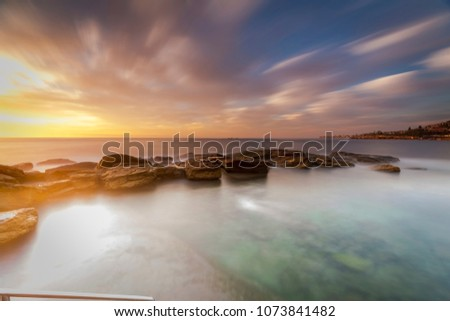 Long exposure of sunrise at Coogee Beach, Sydney, Australia