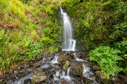 Long exposure of the Hollowbrook waterfall on the South West Coastpath from Woody Bay to Heddons Mouth in Devon