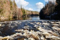Long exposure photo. Dam and threshold on the river Jokelanjoki, Kouvola, Finland