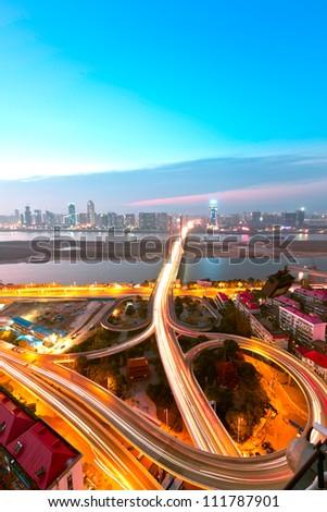 Long exposure photo of city ring road viaduct night scene