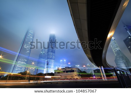 Long exposure photo of light trails on the modern buildings background in shanghai