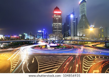 Long exposure photo to dazzling rainbow overpass highway night scene in Shanghai