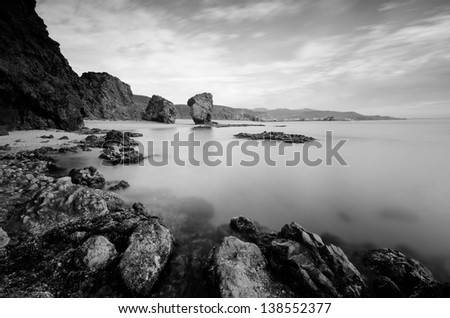 Long exposure photograph in black and white of one of the best beaches in Spain,with volcanic rocks and christal waters in the beach known like La Playa de Los Muertos ( Beach of the Dead ).Carboneras