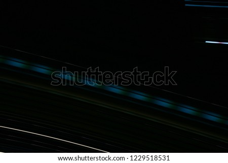 Long exposure photograph of moving lights.Abstract light effect on a black background.  #1229518531
