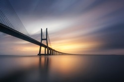 Long exposure photography on the Vasco da Gama bridge in Lisbon at sunrise