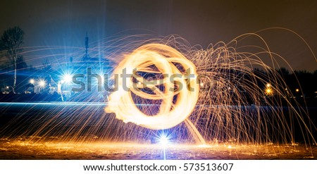 Long exposure photography with the fire ball at night #573513607