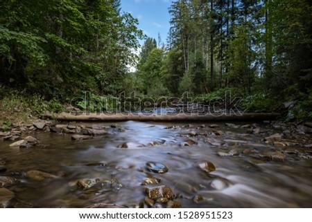 Long exposure river on Polish village. Biały Potok river in Zubrzyca Gorna, Poland.  08.22.2019 Zdjęcia stock ©