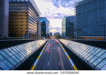 Long exposure shot from a bridge in Brussels. Traffic tunel and Europen headquarters in the foreground Stockfoto ©