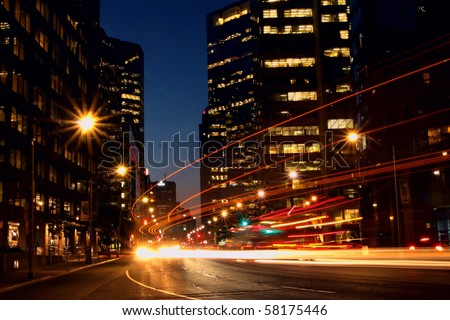 Long exposure shot of a busy street at night creating dynamic effect of the vehicle lights. photo taken Toronto Canada