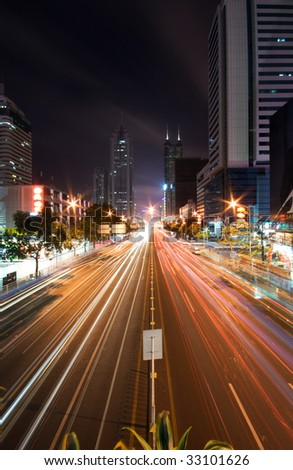 Long Exposure Shot of a City Highway - stock photo