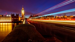 Long exposure shot of Big ben and westminster parliament of London, UK with beautiful sunset behind the city