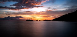 Long exposure shot of Boats in the sunset, in Bayawan, Negros Oriental, Philippines