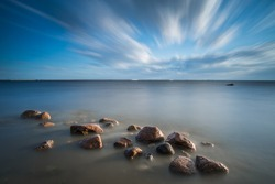 Long exposure shot of clouds passing by on Gulf of Finland near Saint - Petersburg, Russia.