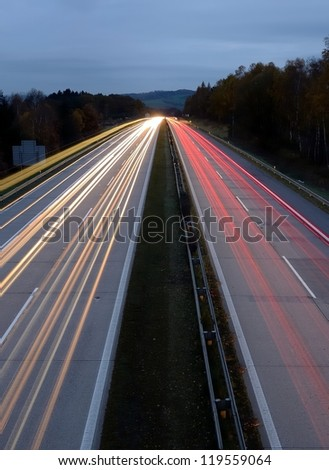 Long exposure shot of highway at night.
