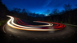 Long exposure showing the movement of traffic around horseshoe curve in the Appalachian mountains