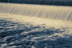 Long exposure showing water patterns of dam water flowing