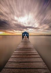 long exposure sky clouds water bridge shed house