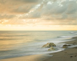 Long exposure smooth and dreamy beach sunrise with coastal view from South Florida