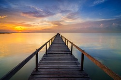 Long Exposure Sunrise Seascape with Abandon Jetty, Teluk Tempoyak, Pulau Pinang, Malaysia. Soft Focus & noise visible.