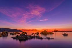long exposure Sunset twilight sky at Songserm port thong sala beach suratthani thailand