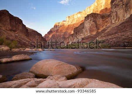 Long exposure taken from the edge of the Colorado River through the Grand Canyon at sunset